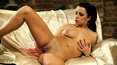 Romana fingering and toying her pussy in a hot solo European porn video