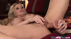 Blonde sucks on her biggest toy and penetrates herself with it