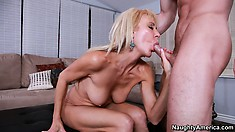 Busty mature blonde Erica Lauren takes his sweet young meat in her twat