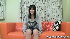 Dazzling Asian girl with a pretty smile and sexy feet has wild desires to fulfill