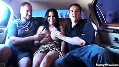 Busty broad has fun showing off her huge titties in a limousine