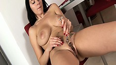 Adrianne drives a huge glass dildo in her peach until she satisfies her desires