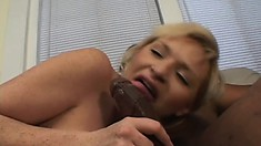 Cute blonde with a sweet ass Michelle fulfills her sexual fantasies with a black rod