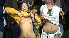 The best way to get beads at Mardi Gras is by showing your tits