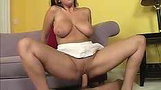 Lovely college girl with enormous tits uses them to pleasure her man