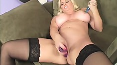 Curvy blonde with huge tits loves choking on a black monster cock