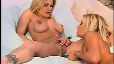 Two hot blonde lesbians that would make a dick rise just looking at them toy and eat pussy