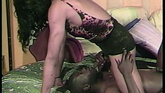 Bald black stallion loves getting his python serviced by a horny hunk