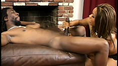 Stunning ebony girl with tiny boobs enjoys a cigarette and jerks a black rod to orgasm