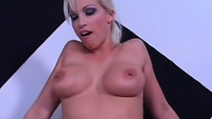 Buxom blonde Nikki Hunter has a black rod banging her holes from behind