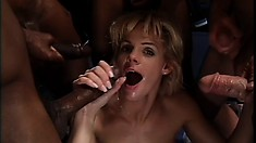 Two slutty gals in an interracial gangbang sucking dick and getting pumped