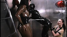 Latex fetish lesbians indulge in a moment of freaky lady loving