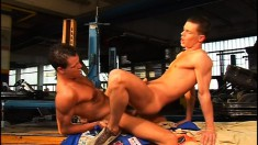 Two muscled guys fulfill their sexual fantasies in the auto garage