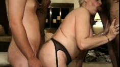 Short haired mature blonde in sexy stockings takes on four horny studs