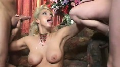 Two stacked ladies get their asses pounded rough by a well hung stud