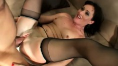 Sexy mature woman in black stockings wildly fucks a young stud's cock
