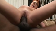 Alluring young redhead offers her lovely snatch to a hung black stud