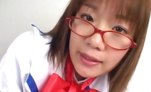 A cute japanese school girl with glasses teases the camera